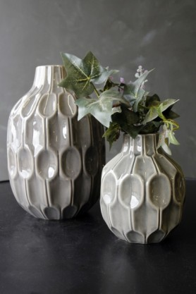 lifestyle image of Set Of 2 Grey Honeycomb Print Vases with ivy inside on black table