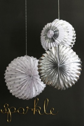 lifestyle image of Set Of 3 Foil Globe Decorations - Silver with sparkle ornament on dark grey background