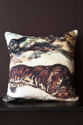 Lifestyle image of the Sleeping Tiger Velvet Cushion on black bench with dark wall background