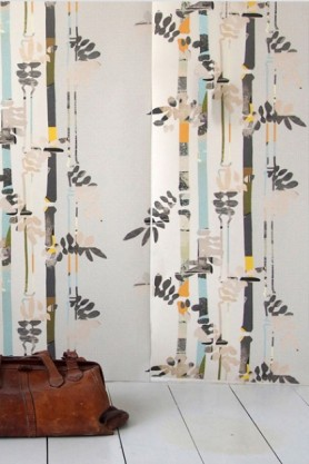 lifestyle image of Smink Things Bamboo Trees Wallpaper with brown leather bag on white wooden flooring