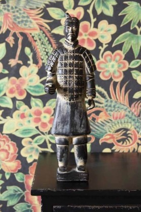 Lifestyle image of the Standing Qin Dynasty Figure Ornament on black side table with Rockett St George Oriental Garden Wallpaper in background