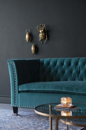 Lifestyle image of the right end of the Teal Velvet Chesterfield 3 Seater Sofa With Stud Detail