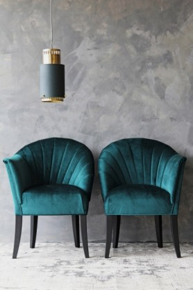 lifestyle image of The Lovers Velvet Chair - Ocean Deep Green with gold and green pendant ceiling light and grey wall background