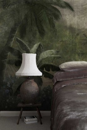 Lifestyle image of the Tropical Paradise Wallpaper Mural - Kodo Maca in bedroom with bed and side table with table lamp