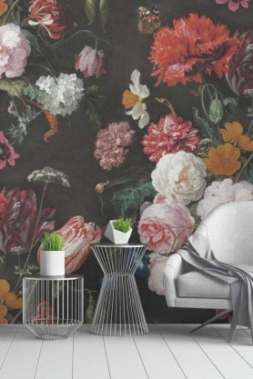 Lifestyle picture of the twilight floral wall mural in a living room with two metal side tables and white wooden flooring