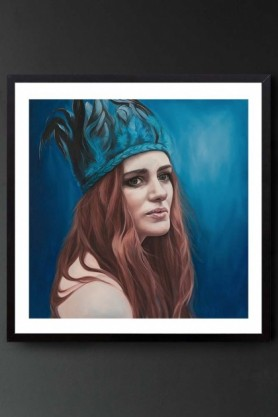 "lifestyle image of Unframed Art Print by Amy Carter ""Festival"" woman with red hair wearing blue headdress on blue background in black frame on dark wall background"