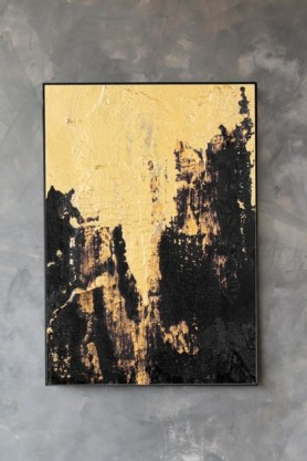 lifestyle image of Unframed Disco Deluxe Art Print yellow gold and black painting in black frame on distressed grey wall background
