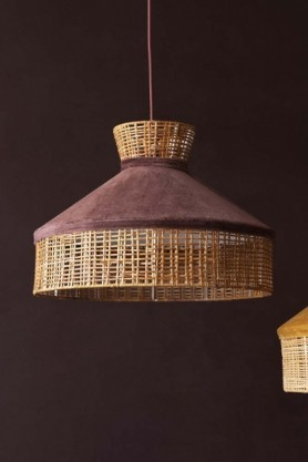 Lifestyle image of the Burgundy Velvet & Rattan Pendant Ceiling Light on a dark brown wall background