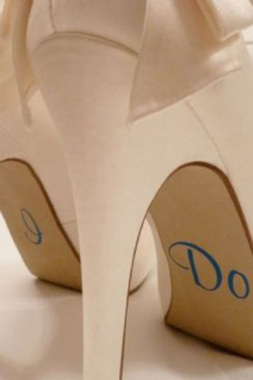 Image of I DO on the sole of brides shoes