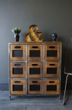 lifestyle image of Hudson 9 Drawer Wooden Storage Chest Of Drawers with ornaments on top and grey wall background