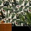 square lifestyle image of Witch & Watchman Amazonia Wallpaper - Light with wooden coffee table and plant