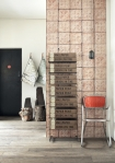 lifestyle image of NLXL TIN-06 Brooklyn Tin Tiles Wallpaper By Merci in entrance hall with black door and orange chair