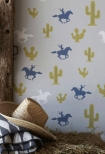 lifestyle image of Hibou Home Cactus Cowboy Children's Wallpaper with cowboy hat and hay