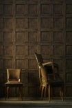 lifestyle image of Andrew Martin Engineer Collection - Regent Oak Wood Panelling Wallpaper - 2 Colours Available with small chair and armchair