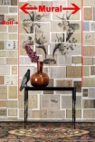lifestyle image of NLXL EKA02 Biblioteca Wallpaper by Ekaterina Panikanova - Mural 2: Antlers with black table and brown vase with pink flower in with red markings