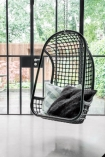 Lifestyle image of the Black Rattan Hanging Chair