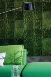 lifestyle image of Designers Guild Aquarelle Wallpaper - 5 Colours Available with green sofa and black shade ceiling light