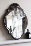 Lifestyle image of the Vintage Style Foxed Wall Mirror
