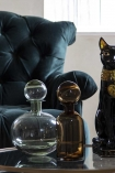 Lifestyle image of both the Glass Decanter Bottles With Ball Stopper