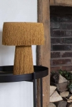 Image of the Mustard Yellow All Over Fringe Table Lamp sitting on a tray table