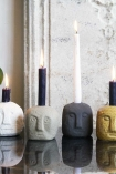 Lifestyle image of the Quirky Face Candle Holders on a sideboard