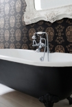 lifestyle image of Day of the Dead Skull Wallpaper - Gold & Black with black and white bath tub