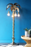 Palm Tree Floor Light with blue wall background rattan side table and monochrome rug lifestyle image