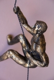 Close-up image of the Right Handed Abseiling Man In Antique Gold