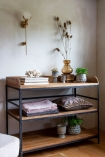 Close-up lifestyle image of the Antique French-Style Shelf Unit / Console Table