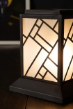 Close-up image of the Art Deco Lantern Design Table Light switched on