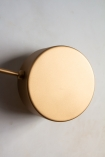 Close-up front on image of the discs on the end of the arms on the Art Deco Statement Wall Light