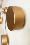 Close-up side view image of the discs on the end of the arms on the Art Deco Statement Wall Light