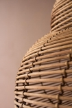 Close-up image of the rattan detail on the Beautiful Spiral Shell Shaped Rattan Ceiling Light