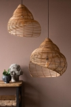 Lifestyle image of both the small & large Beautiful Spiral Shell Shaped Rattan Ceiling Light