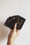 Image of the Black & Gold Playing Cards held in a hand