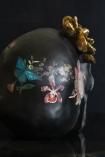 Image of the back of the Black Feminine Skull With Gold Flower Ornament