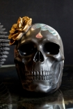 Image of the front of the Black Feminine Skull With Gold Flower Ornament