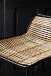 Close-up image of the seat on the Black Framed Natural Rattan Bar Stool