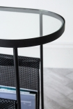 Close-up image of the top on the Black Lozenge Shaped Glass Side Table With Magazine Rack