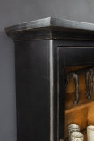 Image of the top left corner of the Black Wooden Glass Display Cabinet