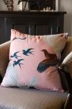 Left-angle lifestyle image of the Blush Pink Birds Print Velvet Cushion