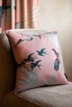 Right-angle lifestyle image of the Blush Pink Birds Print Velvet Cushion