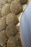 Close-up image of the shell detail on the Round Mirror With Antique Gold Shell Layers