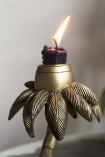 Close-up image of the candle holder on the Cool Leopard Sheltering Under A Palm Tree Candle Holder