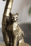 Close-up image of the Leopard on the Cool Leopard Sheltering Under A Palm Tree Candle Holder