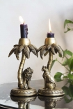 Lifestyle image of both the Majestic Lion & Cool Leopard Sheltering Under A Palm Tree Candle Holder
