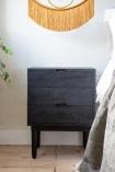 Lifestyle image of the Bureau-Style Black Mango Wood Bedside Table