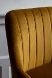 Close-up image of the material detail on the back of the Golden Ochre Casino Velvet Bar Stool