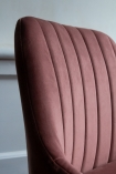 Close-up image of the material and detail on the seat back on the Rose Pink Casino Velvet Bar Stool