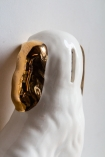 Image of the back of the Hand Painted UK Made Cavalier King Charles Spaniel Dog Coin Bank's Head showing the coin slot